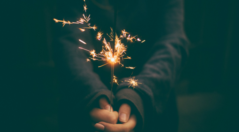 holding a sparkler
