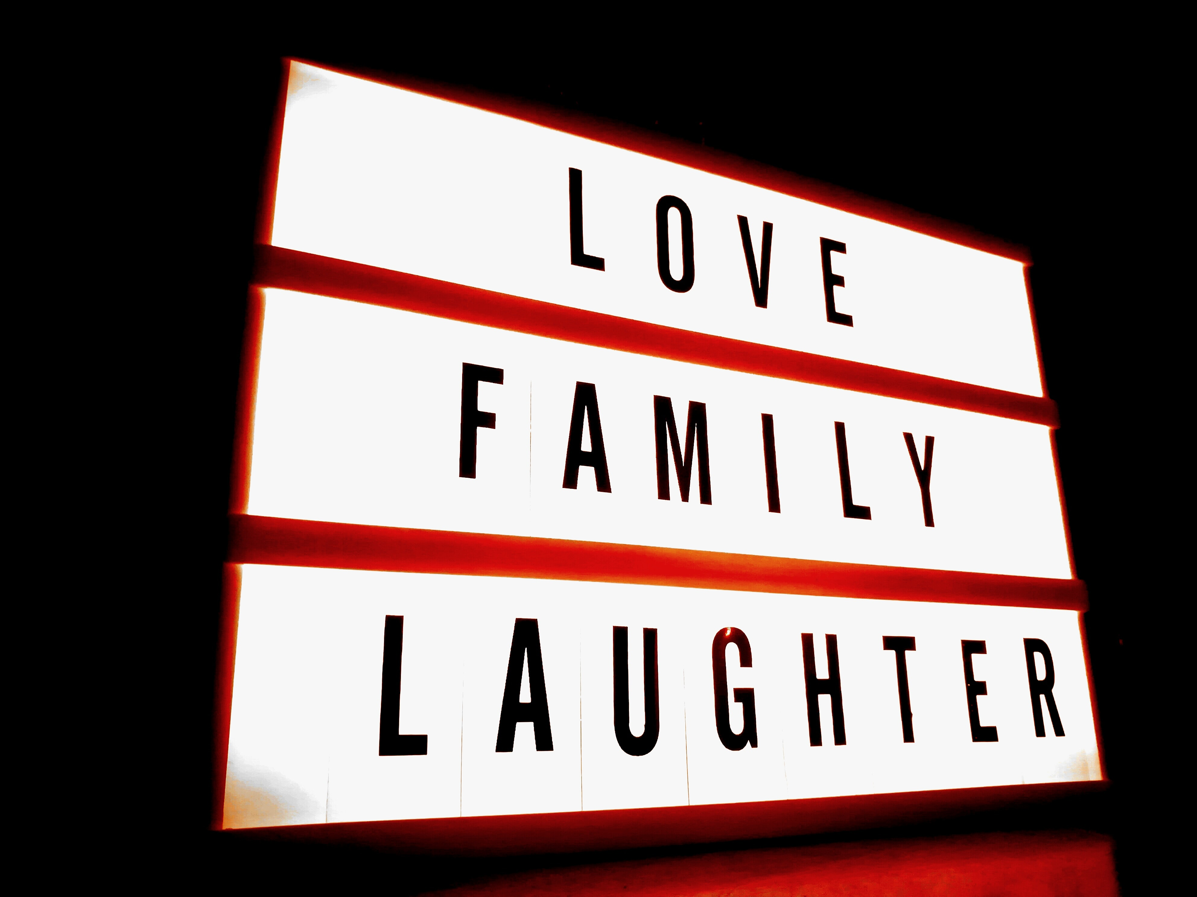 Love, family, laughter sign board