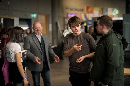 Image of Pocket Sized Hands staff talking to Discover Digital participant