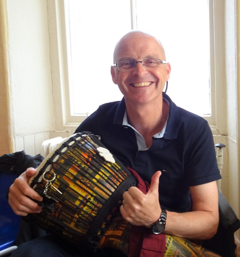 Photo of man smiling with drum