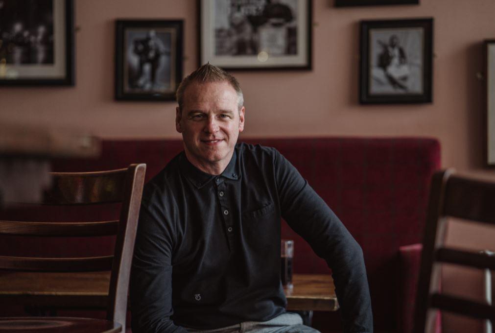 Man sitting in Clutha Bar Glasgow
