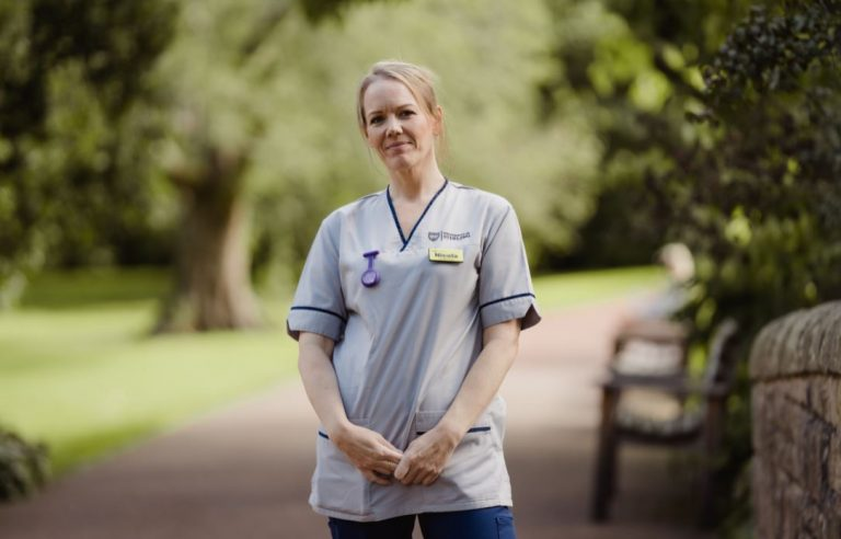 Woman in nurse uniform standing in park