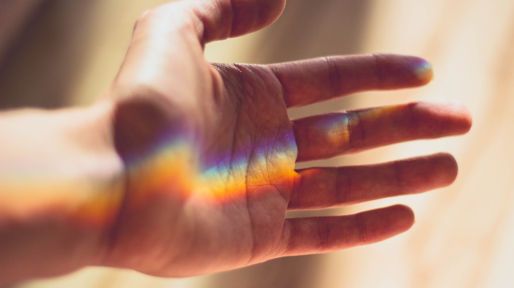 Hand with rainbow